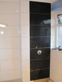 Fitting tiles over shower mixer